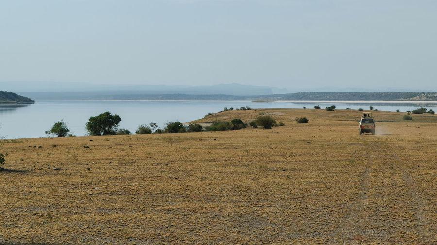 Scenic view of beach against sky, lake magadi, kenya