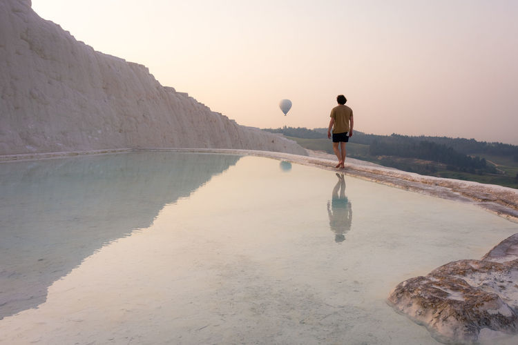 More on www.mscgerber.com Finally made it to the travertines in Pamukkale. We went there at 6:30 AM when the park opened to avoid tourists: A good decision! One hour later this beautiful place was totally overcrowded with tourists. Hierapolis Middle East Nature Sunrise Colors Sunrise_Collection Travel Travel Photography Turkey Türkiye Balloon Balloons Europe Guy Guys Hierapolis Nature_collection Pamukkale Reflections In The Water Sunrise Sunrise_sunsets_aroundworld Travel Destinations Travertine Turkey ♡ Turkeyphotooftheday Water Summer Exploratorium