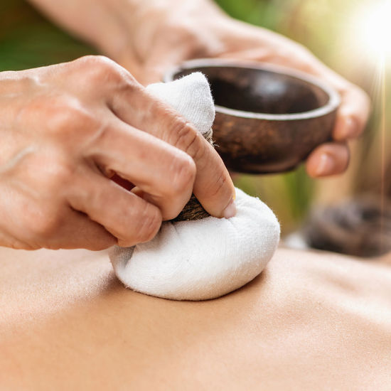 Bolus bag ayurveda massage with medicinal herbs and natural aromatic oils, ayurvedic wellness center