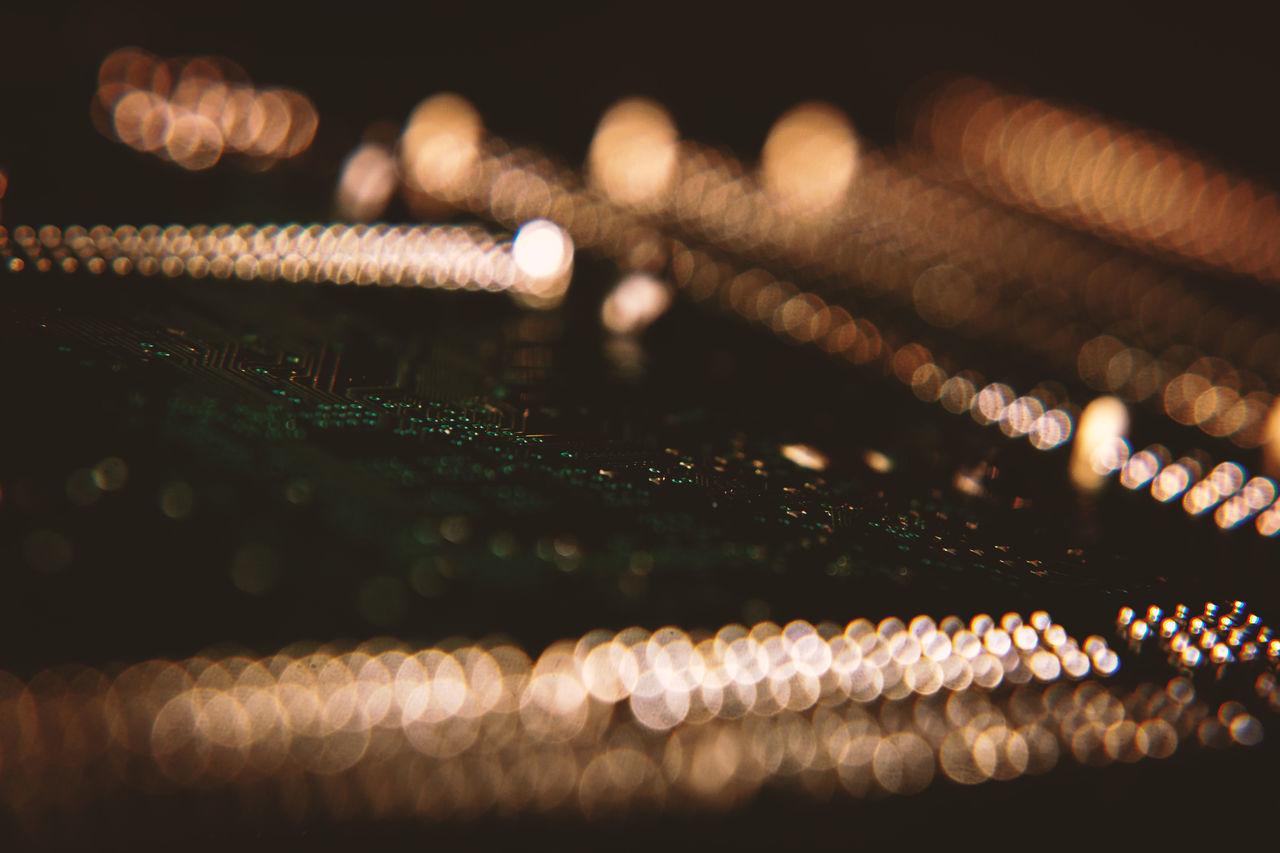 Close-Up Of Illuminated Electric Lights