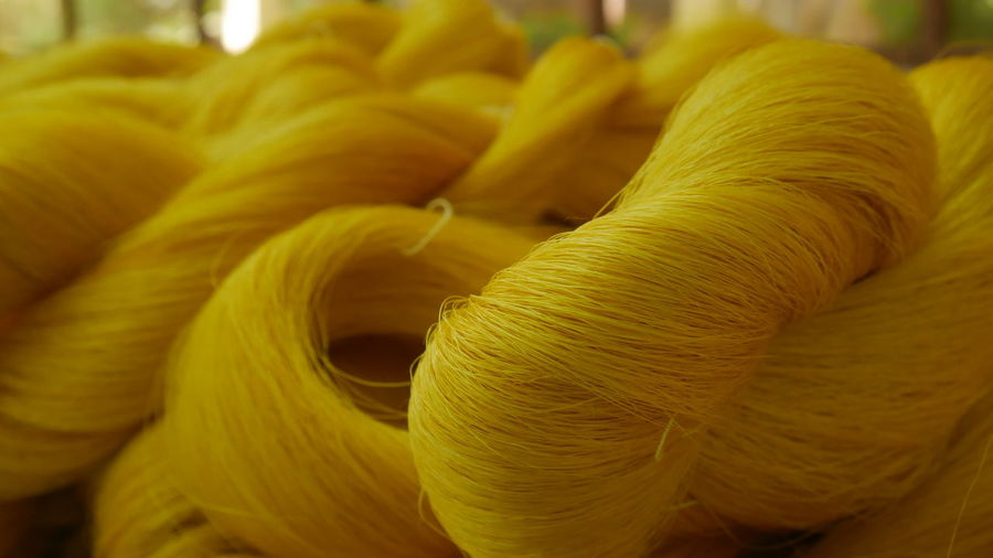 Stack Of Yellow Threads At Textile Industry