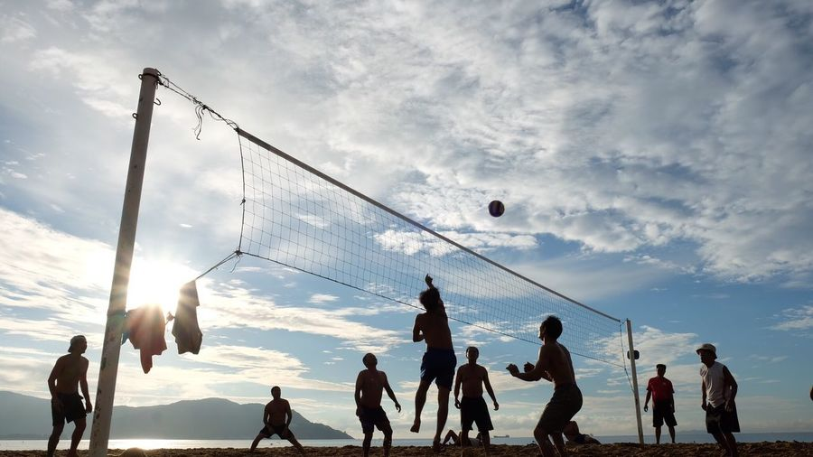 Connected By Travel Playing Sport Cloud - Sky Sky Ball Beach Volleyball - Sport Men Real People Leisure Activity Mid-air Silhouette Medium Group Of People Beach Volleyball Lifestyles Outdoors Sand Day Sea Togetherness Second Acts Be. Ready. This Is Strength Human Connection