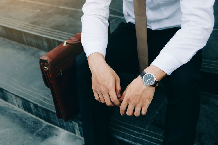 Real People One Person Hand Human Hand Watch Midsection Men Time Wristwatch Architecture Lifestyles Human Body Part Adult Indoors  Well-dressed Formalwear Standing Focus On Foreground Travel