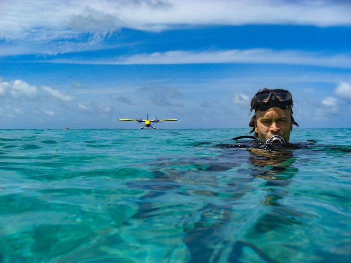 Portrait man swimming in sea