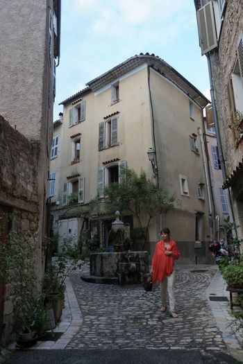 Provence Architecture Building Exterior Built Structure One Person Building Full Length Walking Real People Lifestyles Women Day City Footpath Sky Rear View Nature Adult Street Residential District Outdoors Alley