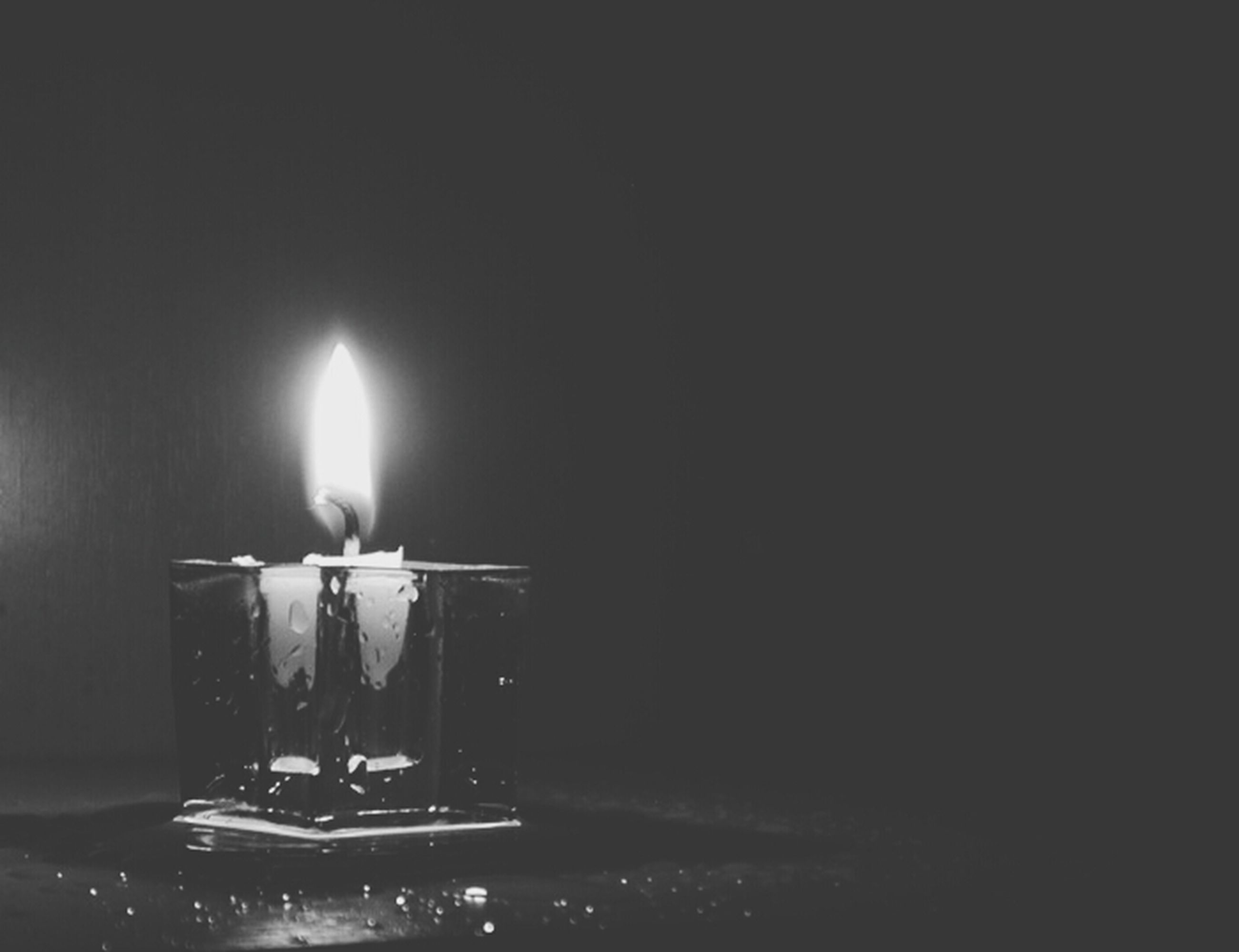 illuminated, burning, night, flame, glowing, lighting equipment, candle, lit, dark, indoors, fire - natural phenomenon, heat - temperature, copy space, darkroom, light - natural phenomenon, close-up, electricity, no people, wall - building feature, candlelight