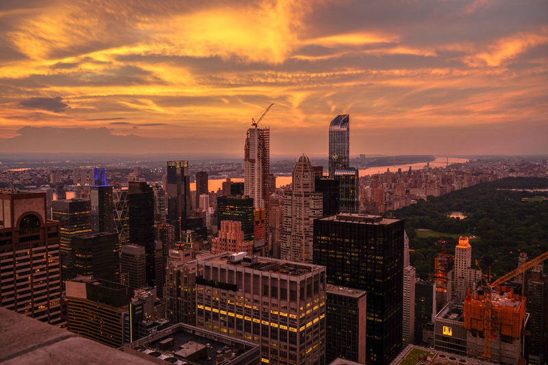 Central Park Scenic Architecture Building Exterior City Cityscape Cloud - Sky Golden Hour High Angle View Illuminated Sky Skyscraper Sunset Top Of The Rock Travel Destinations Urban Skyline Water
