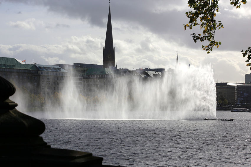 Hamburg Binnenalster Alster lake with spraying Alster fountain Alsterfontäne Binnenalster Hamburg Architecture Beauty In Nature Building Exterior Built Structure Crash Day Force Fountain Long Exposure Motion Nature No People Outdoors Power In Nature Sky Splashing Spraying Water Waterfall