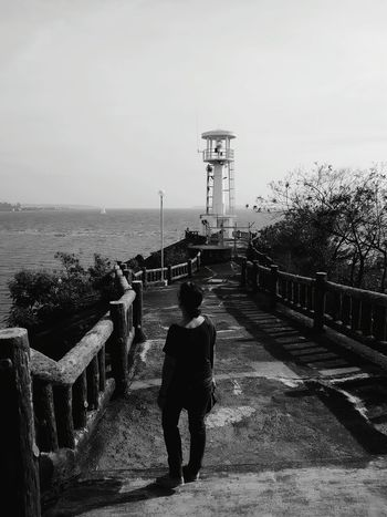 """The Portraitist - 2017 EyeEm Awards """"Relax..."""" Adult Vacations Sea Outdoors Sky Water Summer Nature Look Pure Day Simple STAND Explore Travel Bnw Lighthouse Look Out Subic Ph Taking Photos"""