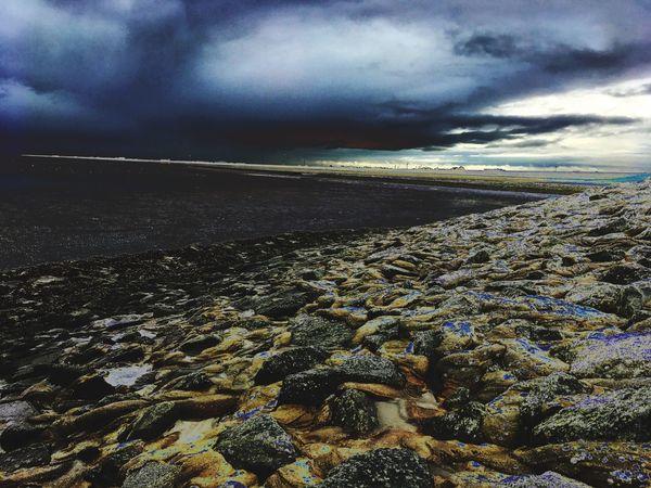 Stony beach over the ocean Neuharlingersiel Ostfriesland Hf-foto Coast Cloud - Sky Sky Tranquility Beauty In Nature Nature Tranquil Scene Scenics - Nature Environment Land No People Landscape Day Outdoors Dramatic Sky Idyllic Sunlight Storm Horizon