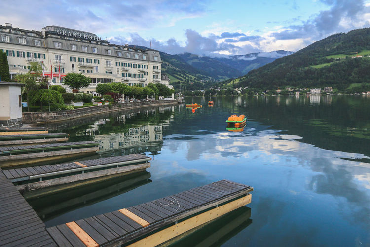 Scenic lakeside hotel in Zell Am See, Austria Country Architecture Beauty In Nature Built Structure Countryside Europe Hotel Jetty Lake Mountain Outdoors Reflection Tourism Tourism Destination Travel Destinations Water Waterfront Zell Am See