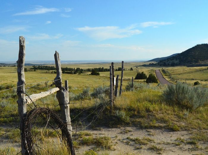 Gate to pasture North On Guernsey Wyoming Along Dirt Road Wood Posts Barbed Wire Wide Open Spaces On The Way To.highway 270