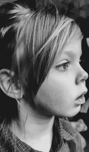 Close-up portrait of young woman looking away