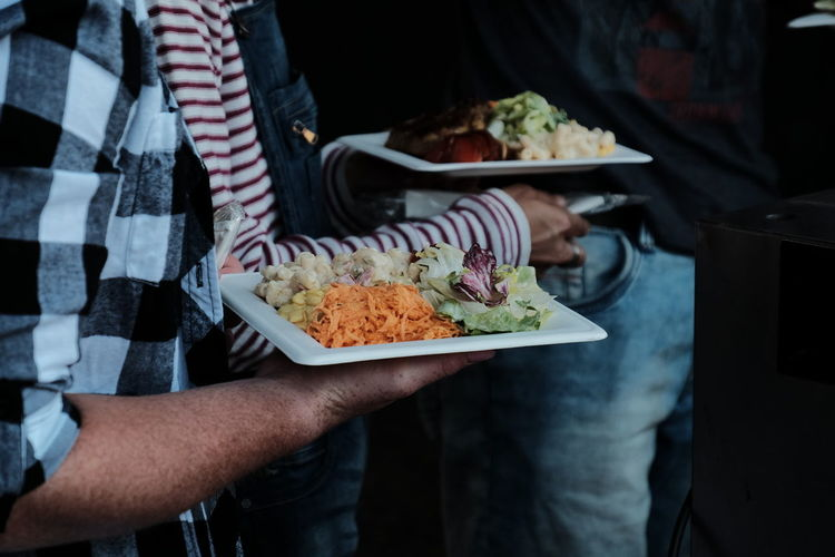 Midsection Of People Having Food