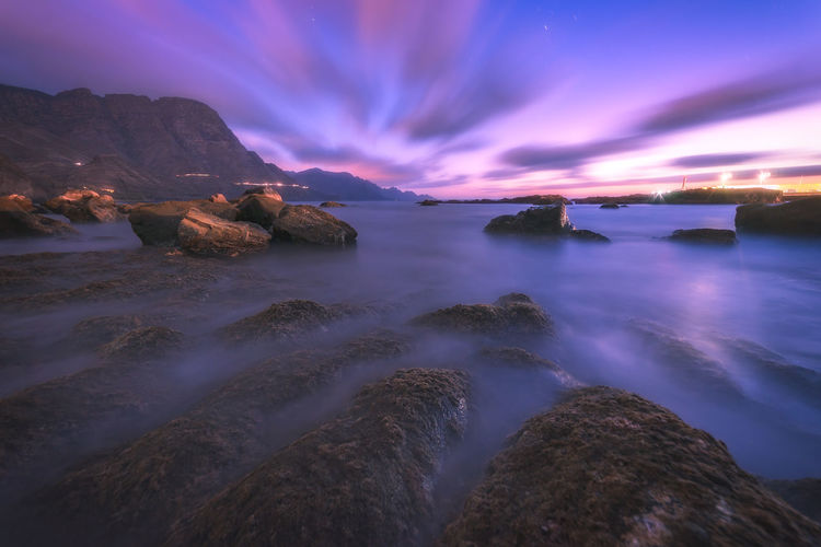 Water Sky Scenics - Nature Beauty In Nature Sea Long Exposure Tranquil Scene Rock Tranquility Cloud - Sky Solid Nature No People Rock - Object Sunset Idyllic Motion Dusk Blurred Motion Astronomy Purple