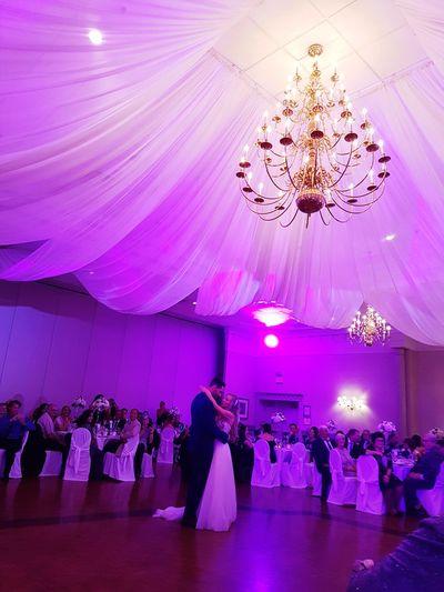 A year ago. Wedding Illuminated Purple Pink Color Chandelier Dance Floor Architectural Design Groom Bride Wedding Ceremony Bridegroom