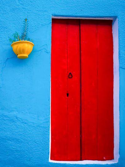 Close-up of closed red door