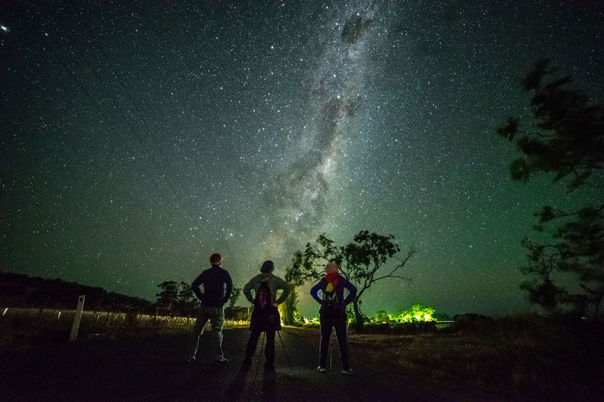 Astrophotographer and stargazing Constellation Galactic Core Astronomy Astrophotography Beauty In Nature Galactic Center Galaxy Group Of People Land Long Exposure Milky Way Nature Night Outdoors People Plant Real People Scenics - Nature Sky Space Standing Star - Space Stargazing Starry Night Tree