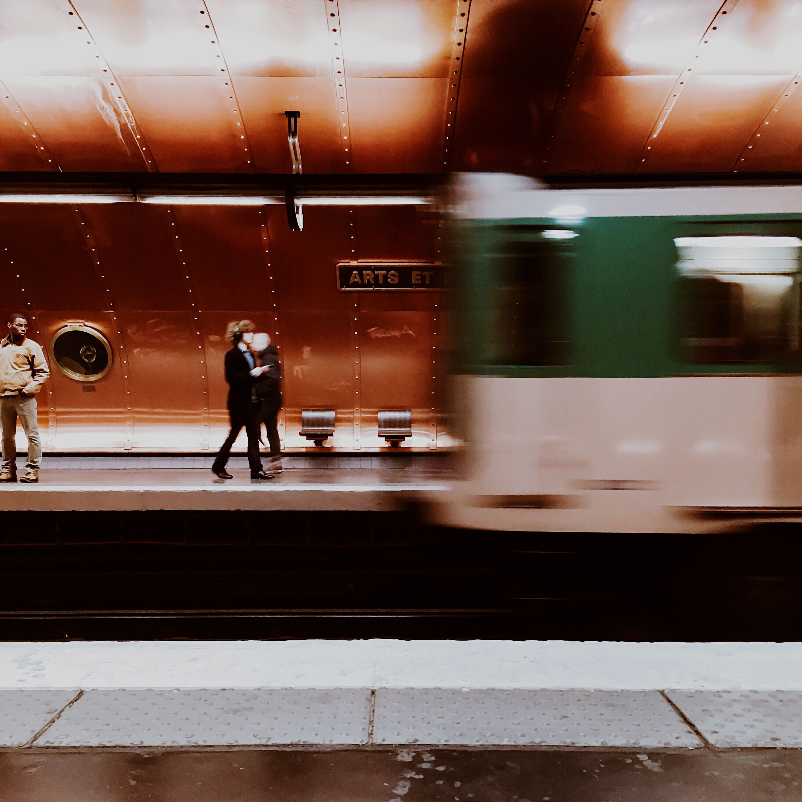 public transportation, transportation, rail transportation, railroad station, railroad station platform, motion, blurred motion, train - vehicle, mode of transport, on the move, speed, men, travel, passenger, illuminated, passenger train, railroad track, walking, train, subway station, waiting, city life, commuter, railway station, casual clothing, journey, person, railway station platform