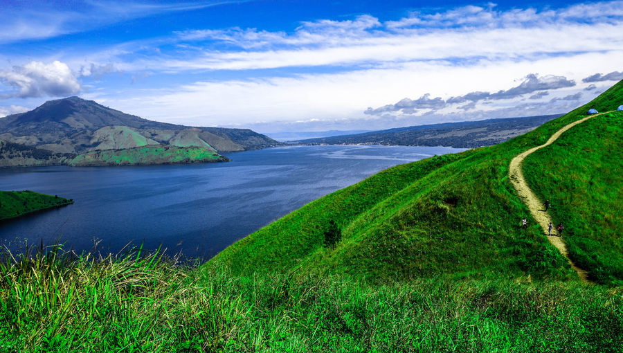 lake toba is beautiful Green Summer Sun Silhouette Shadow Cloud View Calendar Morning Morning Sky Morning Sun Morning View Photography Travel Destinations Travel Traveling Travel Photography Beauty In Nature Sea And Sky Mountain Rural Scene Water Agriculture Tree Field Grass Landscape Sky Mountain Range Volcano Snowcapped Mountain Valley