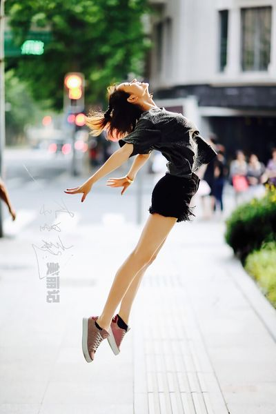 Flying Full Length One Person Motion Real People Mid-air Outdoors Women Jumping City Lifestyles Building Exterior Young Adult Skill  One Woman Only Architecture One Young Woman Only Day Young Women Flexibility Adult Ballerina Photography Ballet Dancer Beautiful Woman