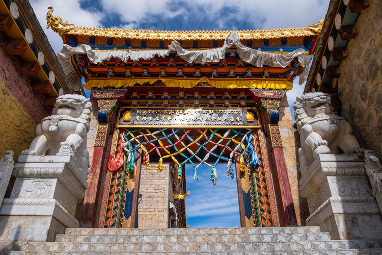 Architecture Built Structure Building Exterior Place Of Worship Religion Belief Sky Spirituality Nature Building Day Low Angle View Art And Craft Cloud - Sky The Past History No People Representation Roof Outdoors Ornate Eaves Architectural Column Temple Shangrila Shangri-La Yunnan China Tibet Mountain