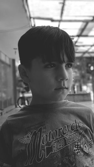 Close-up portrait of boy looking away