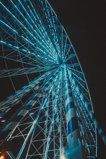 Amusement Park Ride Amusement Park Ferris Wheel Arts Culture And Entertainment Night Low Angle View Illuminated Sky Architecture Built Structure No People Large Nature Fairground Outdoors Tall - High Spinning Motion Building Exterior Shape Nightlife