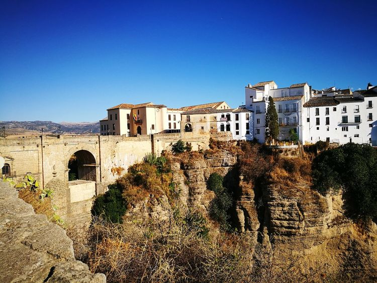 Ronda 2017 The Past History Architecture Building Exterior Built Structure Fort Outdoors Castle Ancient Clear Sky Sky Old Ruin No People Day Ronda Ronda Spain Ronda Andalucia SPAIN Mountain Rocks Ronda Bridge Bridge Stone Wall Bridge Photography Travel