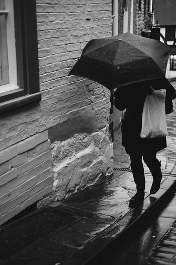 Snow Day Bailgate City City Life City Street FUJIFILM X-T1 Lincoln Lincolnshire People Watching Rain Rainy Days Weather WeatherPro: Your Perfect Weather Shot Black And White Photography Blackandwhite Blackandwhite Photography Bridge Fujifilm_xseries People Street Streetphoto_bw Streetphotography Umbrella Walking Wall - Building Feature Weathered Wood