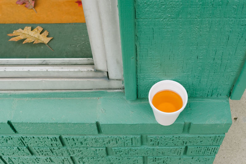 High angle view of drink on wall