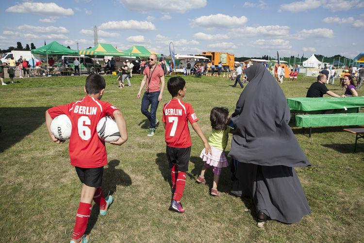 Berlin Boys Burka  Football Team Germany Immigrant Immigrants Integration Lifestyles Migrants Migration Muslim Muslim Woman Niqab Playing Real People Sport Tempelhof Tempelhof Airport Tempelhofer Feld