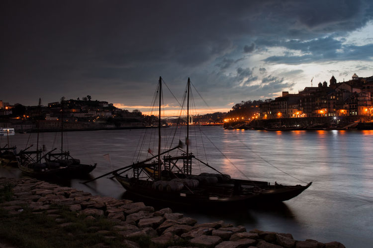 Stormy evening sky above city of Porto and Vila Nova de Gaia in Portugal, Rabelo boats on Douro river. Bad Weather Douro  Dramatic Sky Oporto Porto Portugal Skyline Stormy Weather Travel Architecture Boat Built Structure City Cloud - Sky Europe Moored Nautical Vessel No People Rabelo Boat River Storm Cloud Stormy Transportation Travel Destinations Water