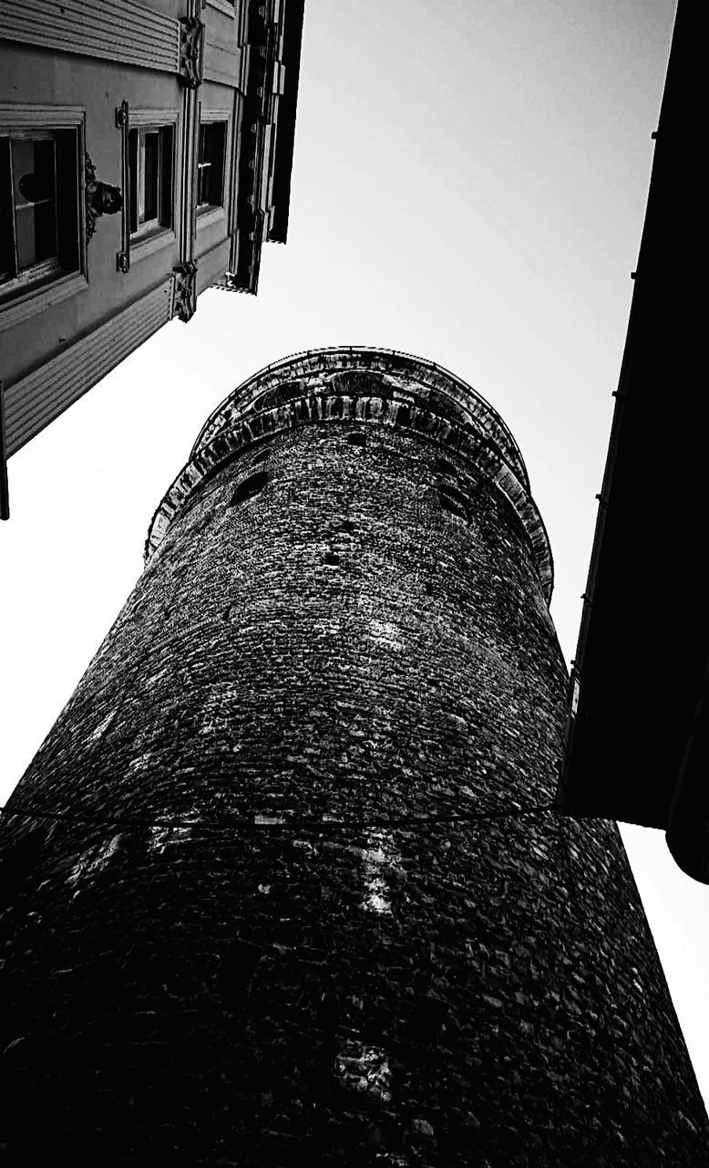 built structure, architecture, building exterior, low angle view, sky, building, no people, nature, clear sky, history, the past, day, tower, outdoors, tall - high, old, window, wall, directly below, brick, stone wall