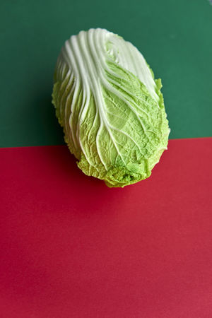 Chinakohl Chinese Cabbage Close-up Colored Background Day Food Food And Drink Freshness Green Color Healthy Eating Indoors  No People Red Still Life Studio Shot Table Vegetable