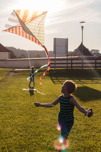 Dragon Freedom Fun Architecture Boys Casual Clothing Childhood Day Full Length Grass Leisure Activity Lifestyles Nature Outdoors Playing Real People Sky Standing To Fly A Kite To Glide To Hang Out The Week On EyeEm This Is Family Visual Creativity 50 Ways Of Seeing: Gratitude