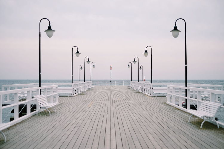 Symmetry of the sea. Pier Sea And Sky Seascape Sea Street Light Water Tranquility Sky Scenics Beach Travel Destinations Outdoors No People Day Landscape Nature Beauty In Nature Horizon Over Water Stories From The City