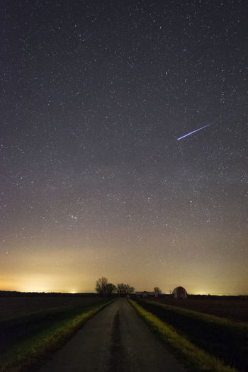 A clear night with stars in the sky illuminate a distant barn Astronomy Barn Beauty In Nature Clear Sky Farm Farmland Galaxy Infinity Iowa Iowa Farms Landscape Nature Night No People Outdoors Road Scenics Sky Space Star - Space Starry The Way Forward Tranquil Scene Tranquility Transportation