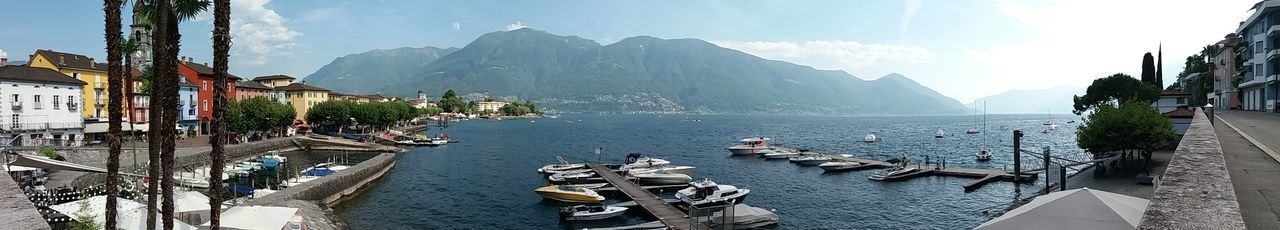 Outdoors Cloud - Sky Day Sky Mountain No People Tree Water Nature Boat Ascona, Ticino, Switzerland Panoramic Photography Panoramic Views Lago Maggiore, Ticino Lake Travel Destinations City Landscape