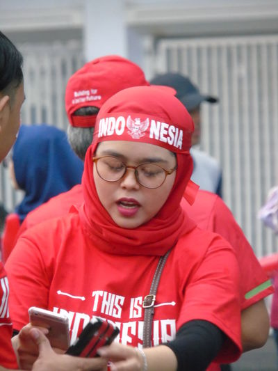Indonesian national team supporters Indnesia Jakarta National Team Supporters Supporter Supporter Football Real People Red Front View Lifestyles Communication People Portrait Telephone Mobile Phone Casual Clothing Teenager Girl Women
