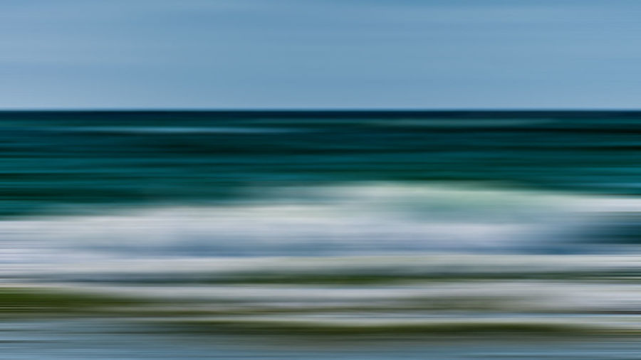 Blurred motion of sea against clear sky