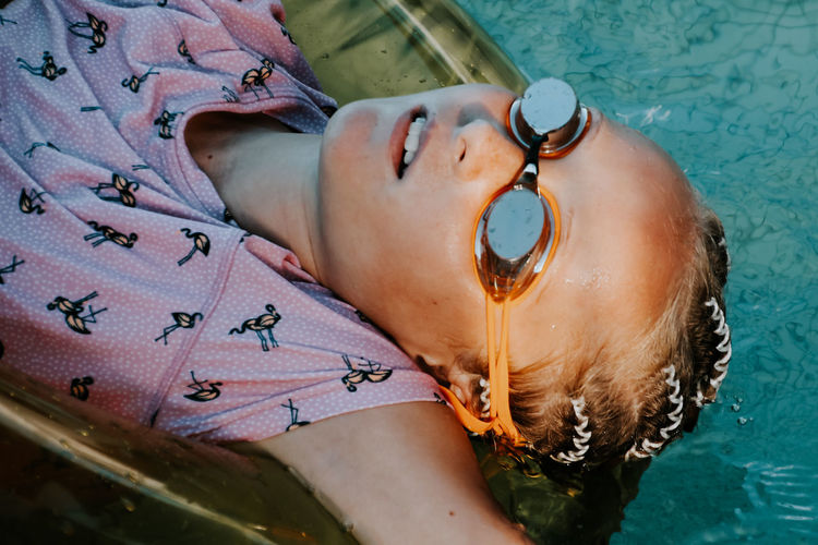 Close-up of girl relaxing at swimming pool