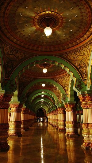 #King's life# Palace#Mysore Palace #palace #India #Karnataka #tourism #tourist Attraction My Best Travel Photo Arch Illuminated Ceiling Architecture Built Structure Mosaic Chandelier Passageway Corridor Pillar Hallway Architectural Feature