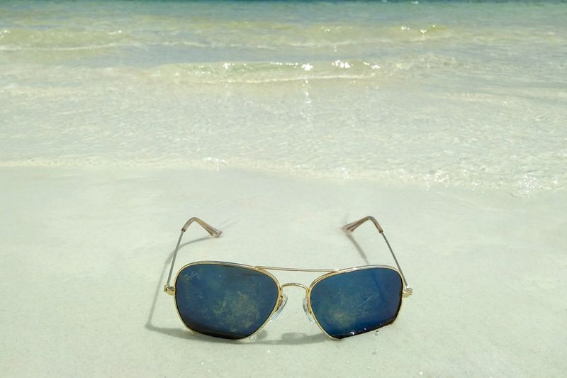 High angle view of sunglasses in swimming pool