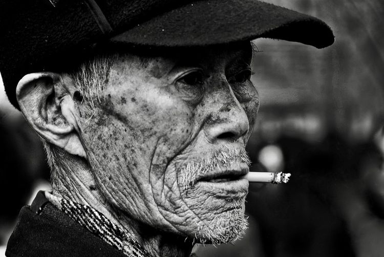 Mister Chang Old Man Of Storr Addiction Bnw Bnw Portrait Bnw_captures Bnw_collection Chinese Cigarette  Close-up Danger Day Focus On Foreground Headshot Lifestyles Old Man Portrait One Person Outdoors People Portrait Real People Senior Adult Senior Men Smoke - Physical Structure Smoking - Activity Smoking Issues The Portraitist - 2018 EyeEm Awards My Best Photo