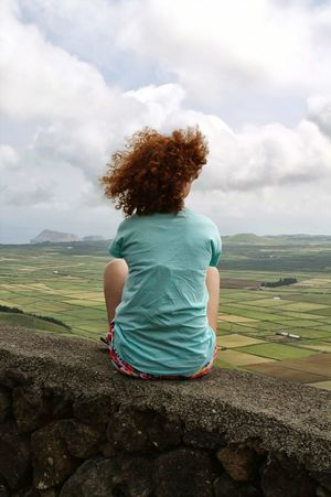 Azores Islands Terceira Cloud - Sky Girl Ginger Relaxation Nature Young Women Sitting Wind Curly Hair Rear View One Young Woman Only One Woman Only Travel Photography Travel Mobile Conversations Mobile Conversations EyeEmNewHere Mobile Conversations Women Around The World