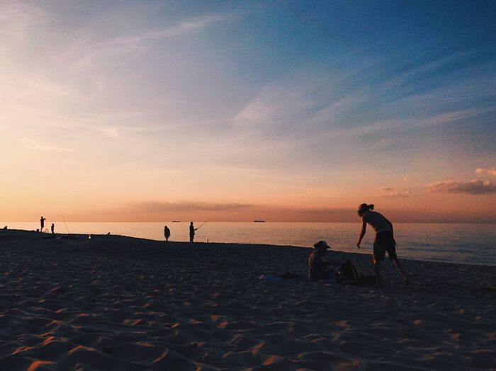 Place Of Heart Beach Sand Sunset Nature Sea Shore Vacations Sky Togetherness Leisure Activity Horizon Over Water Water Outdoors Real People Beauty In Nature Enjoyment Lifestyles Tranquility Playing Men