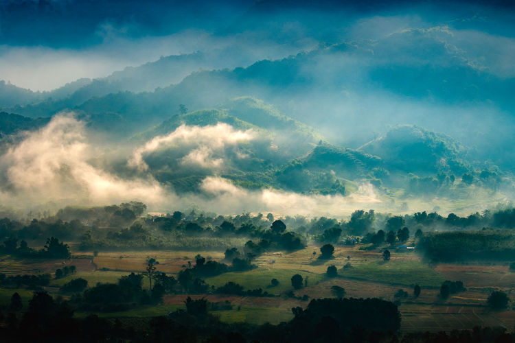 Scenic View Of Landscape And Mountains During Foggy Weather