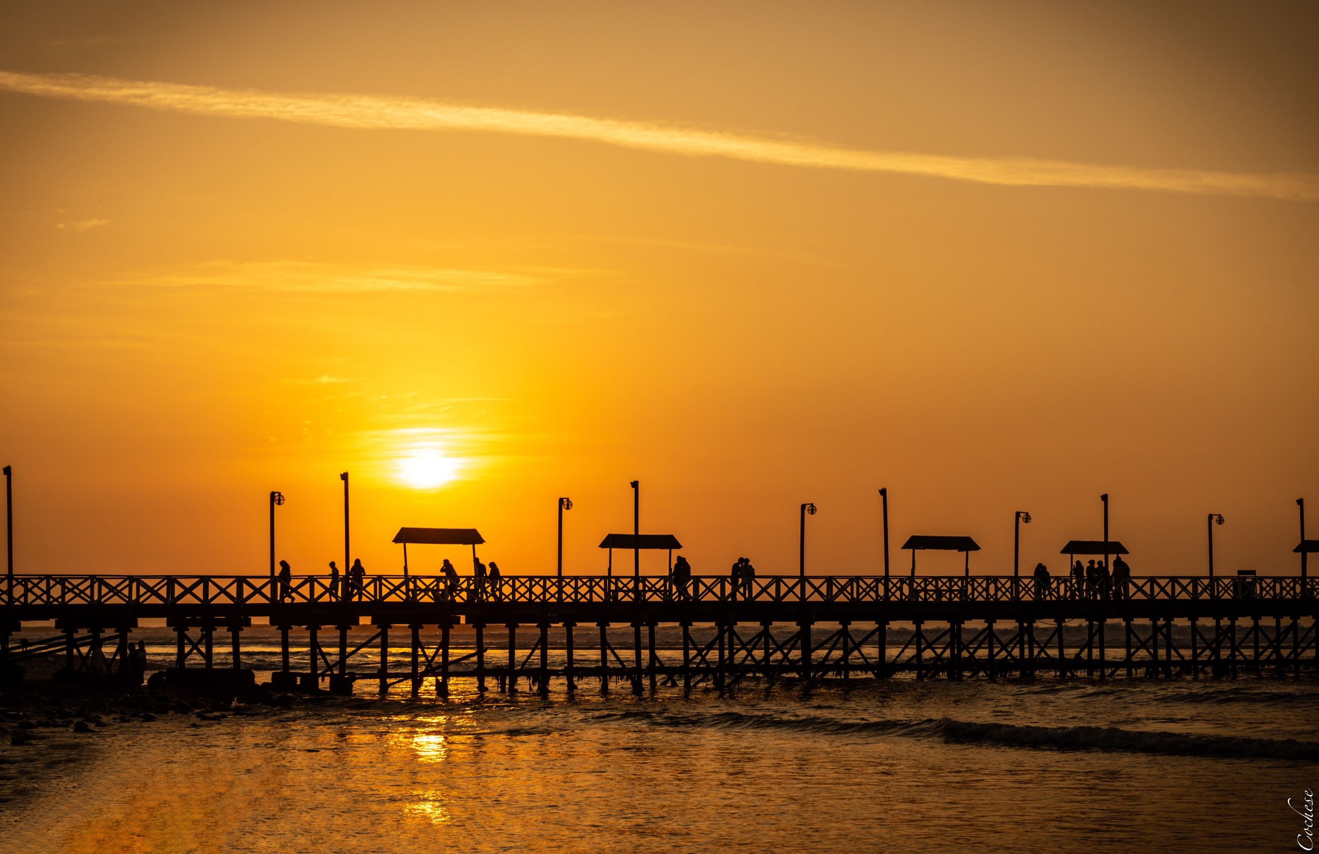 sunset, sky, water, orange color, sea, beauty in nature, architecture, scenics - nature, waterfront, nature, built structure, industry, cloud - sky, pier, no people, sun, silhouette, sunlight, idyllic, outdoors, horizon over water