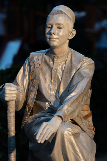 Statue of man sitting outdoors